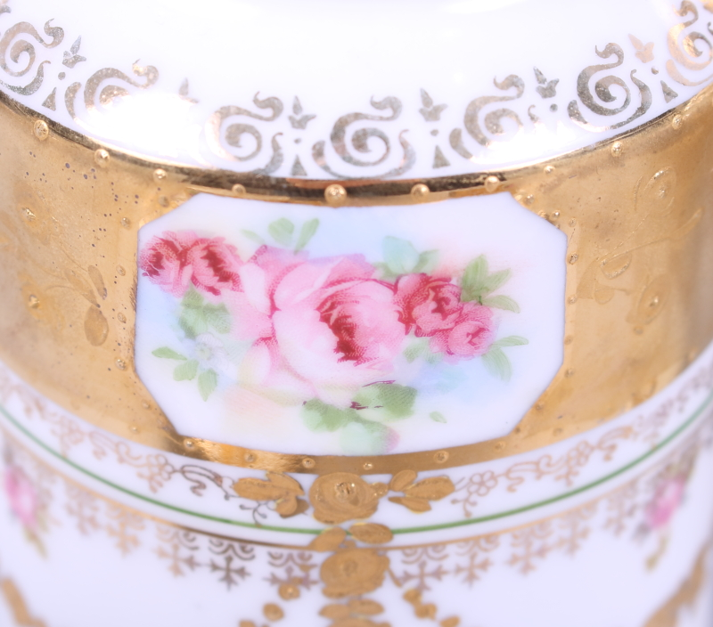 Lot 36 - An Austrian gilt and floral decorated part coffee set, eight pieces