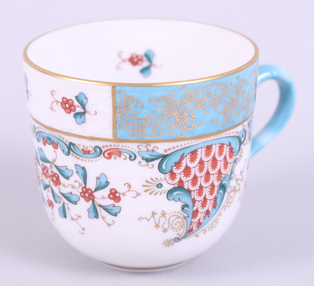 """Lot 12 - A pair of Herend """"Cornucopia"""" pattern cabinet cups and saucers, hand-painted """"Altai Saudonie"""" to"""