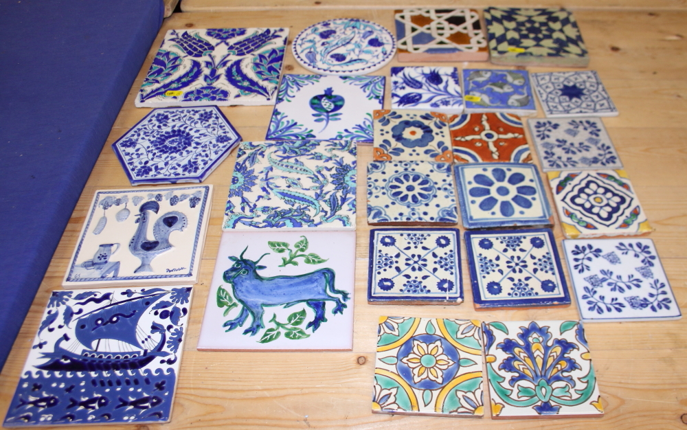 Lot 52 - Four delftware tiles, a larger similar tile and a number of other tiles
