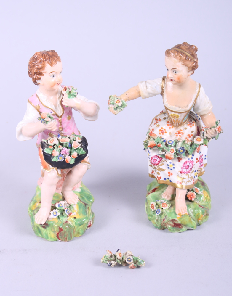 "Lot 9 - A 19th century Derby flower girl and boy, 5 1/2"" high (damages)"