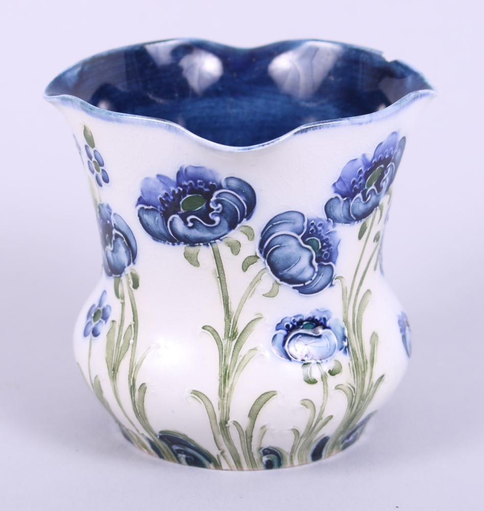 """Lot 2 - A Moorcroft Florian Ware vase, decorated flowers, with green signature to base, 3 1/2"""" high (chip"""