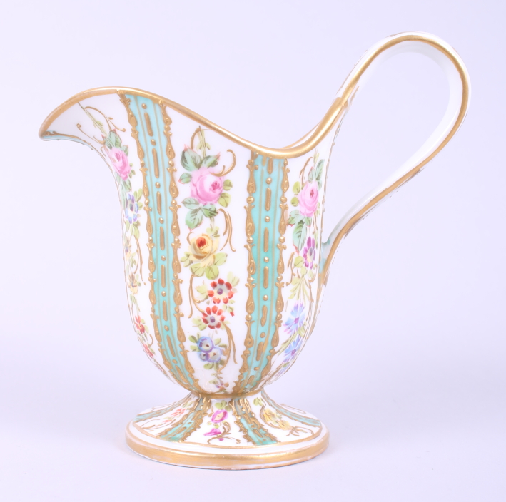 Lot 24 - A Sevres porcelain helmet-shaped pedestal cream jug, decorated floral sprays with turquoise and gilt
