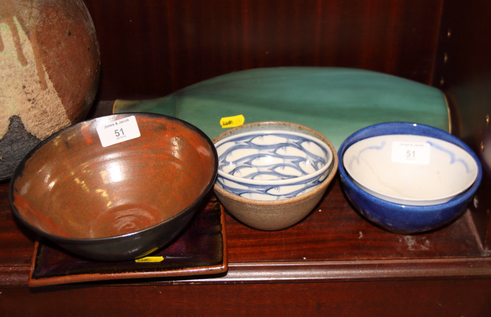 Lot 51 - An assortment of studio pottery including a green glazed vase, bowls, etc