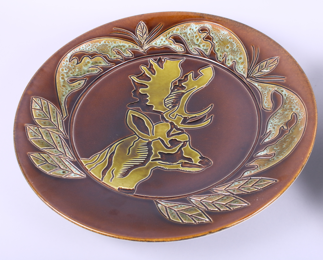 Lot 28 - A Poole Pottery Ionian charger, by Jane Brewer, decorated stag, and another Poole Pottery Aegean
