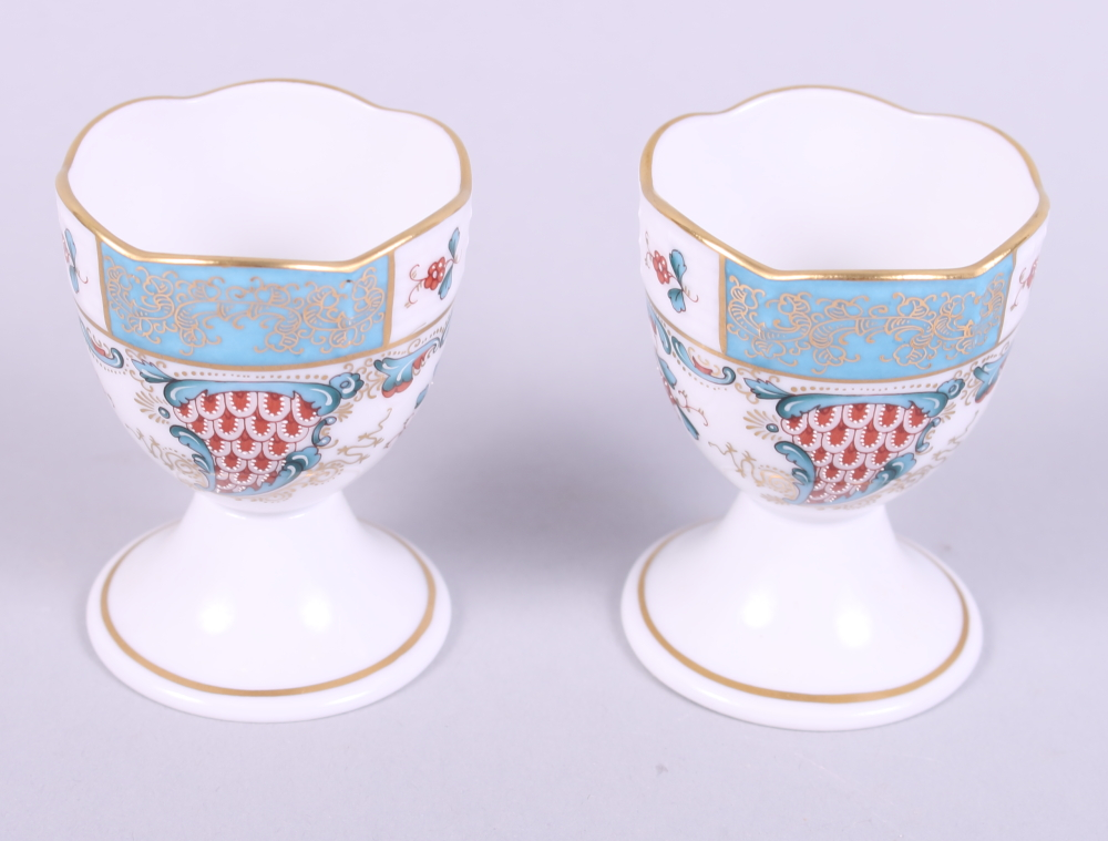 "Lot 14 - A pair of Herend ""Cornucopia"" pattern egg cups with blue, red and gilt decoration and a matching"