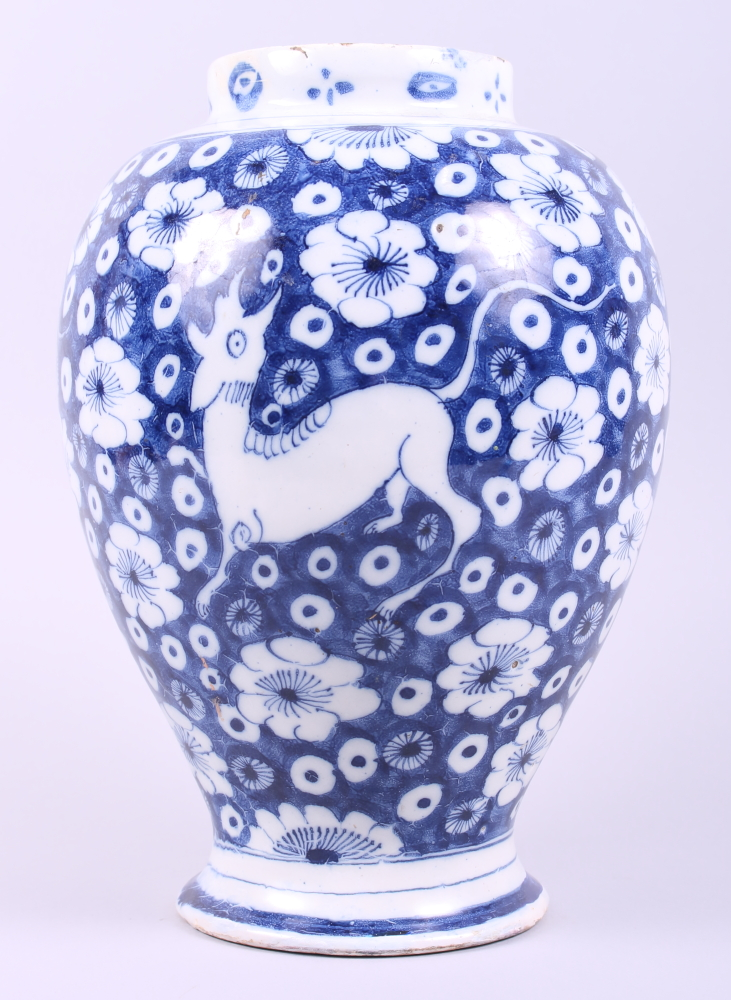 Lot 23 - An 18th century English delft oviform jar (cover missing), decorated flowers and deer, 11 1/4""