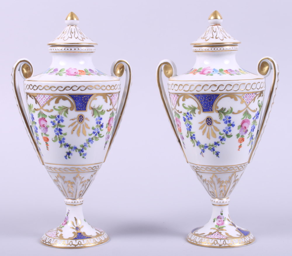"""Lot 26 - A pair of Dresden porcelain two-handled urns and covers with gilt and floral decoration, 8 1/2"""""""