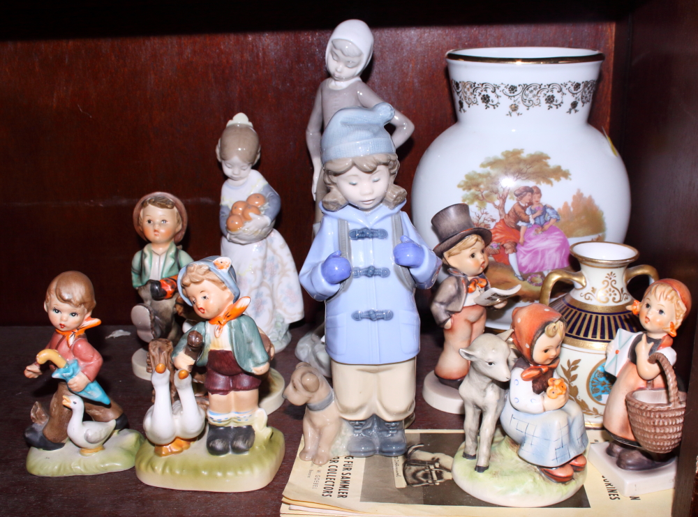 Lot 58 - Two Lladro figures, various Goebel figures, a vase and other items