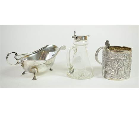A Georgian style silver sauceboat, Sheffield, 1932; a silver topped glass whisky noggin, Birmingham, 1934; and an Indian whit