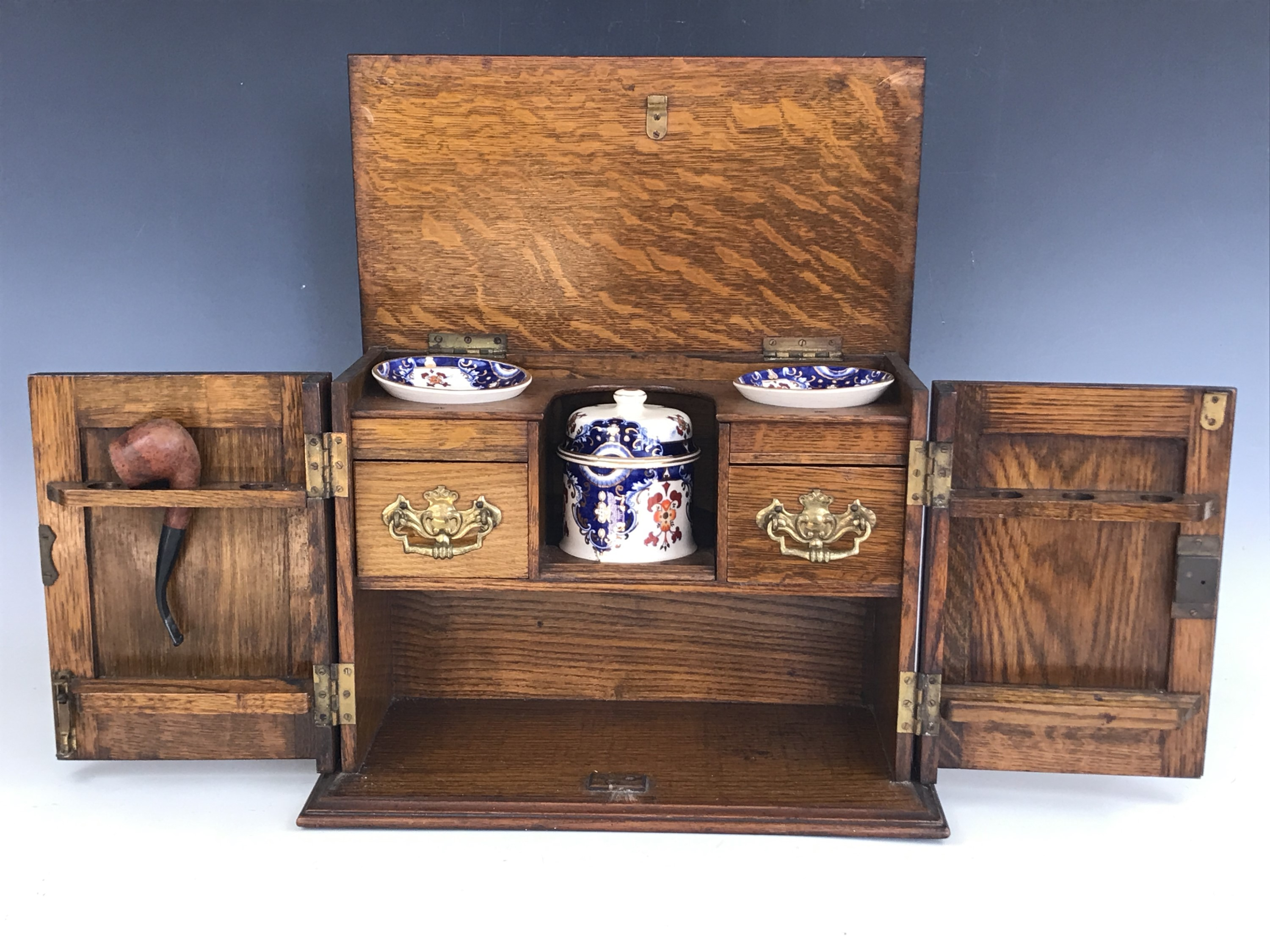 Lot 26 - A late 19th / early 20th Century smokers' oak compendium