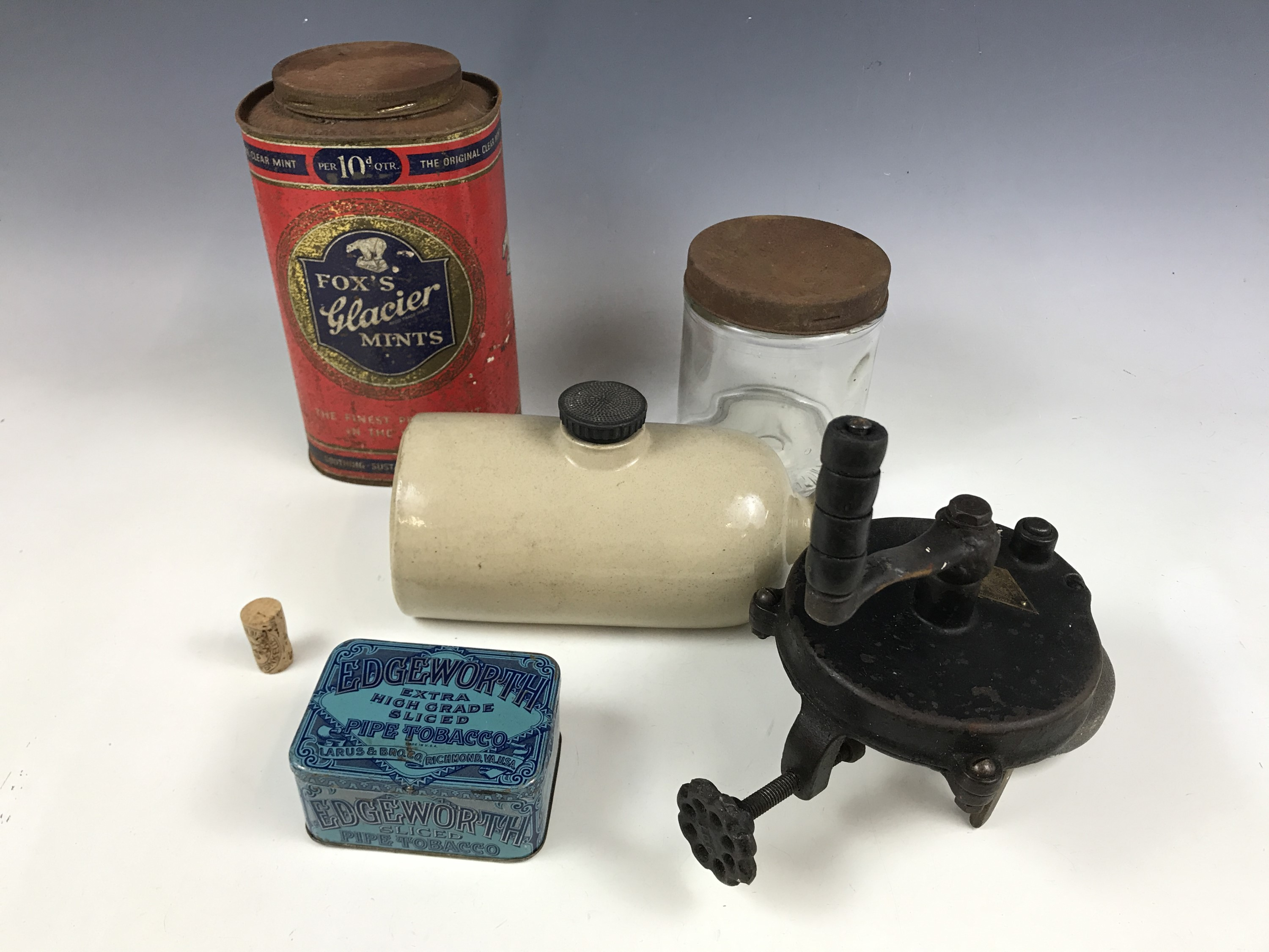 Lot 1 - A stoneware hot water bottle together with vintage tins, a Beech-Nut jar and a grinder