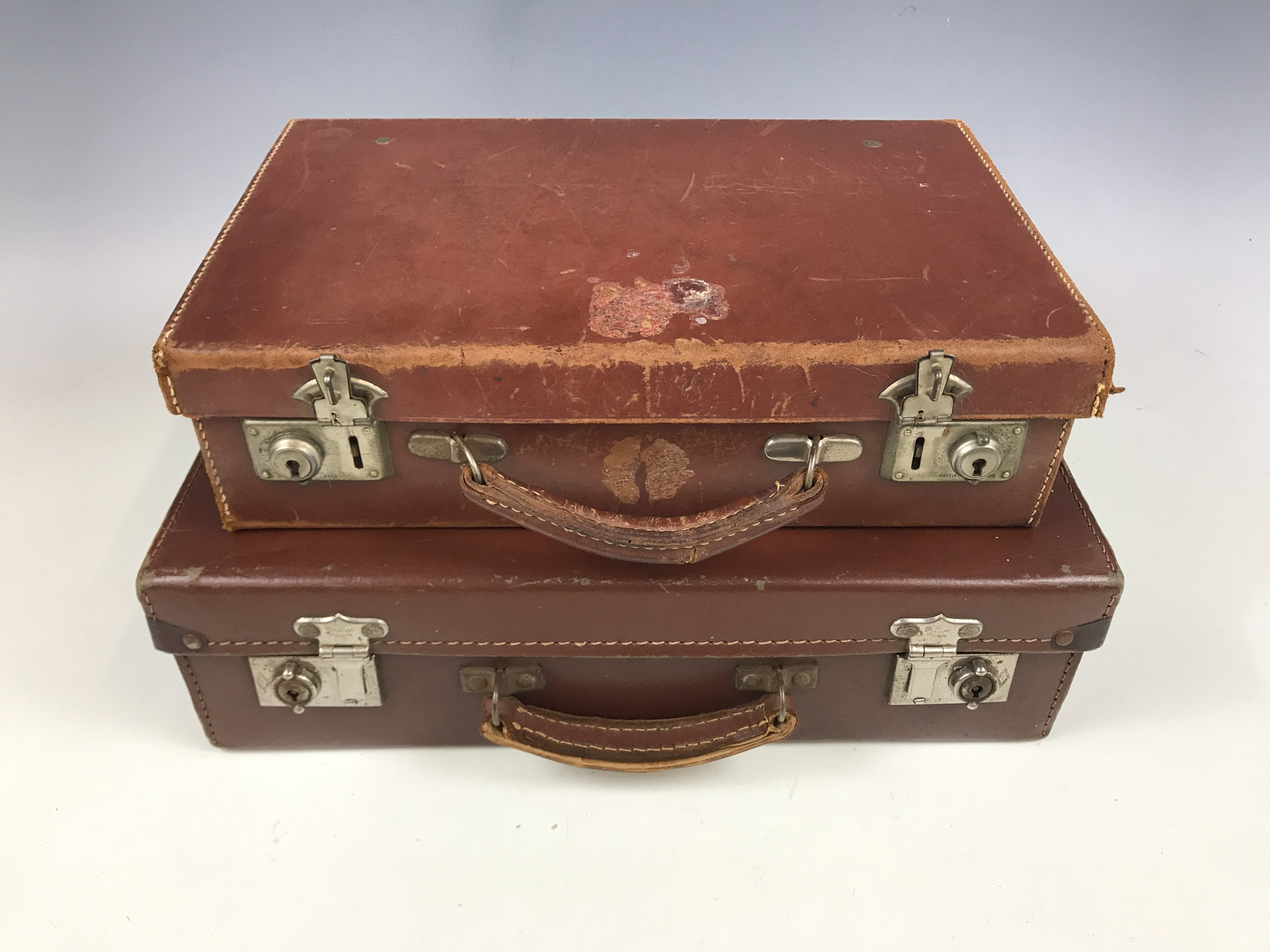Lot 23 - Two vintage small leather / faux travel cases