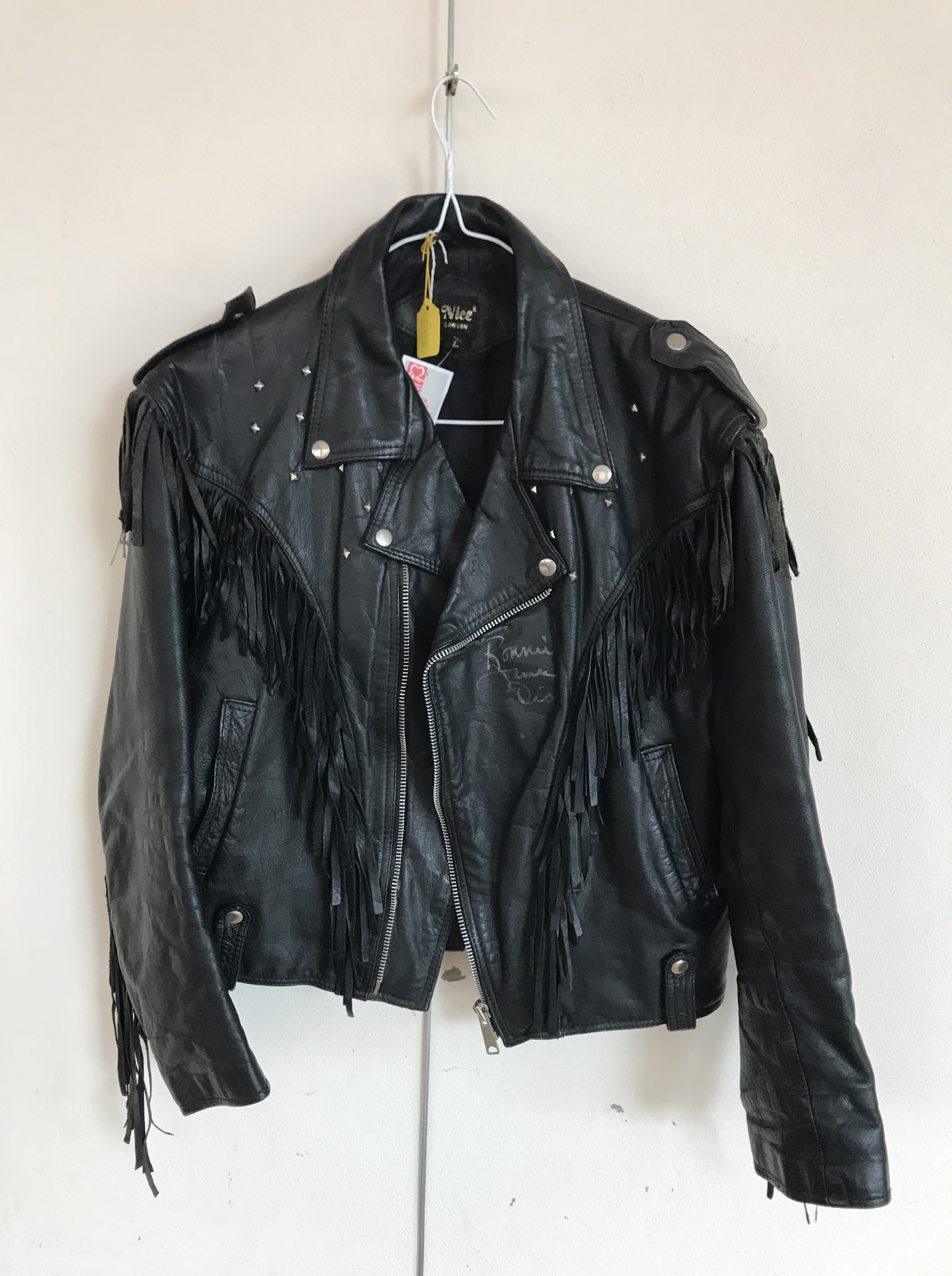 Lot 53 - [Autographs] A fringed leather motorcycle jacket signed by Ronnie James Dio of Black Sabbath /