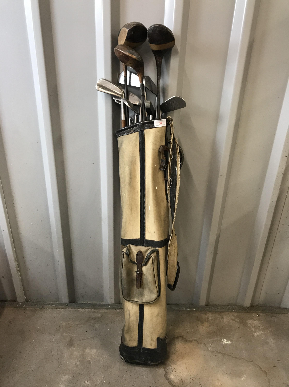 Lot 32 - A vintage golf bag together with a set of Mashie Niblick clubs