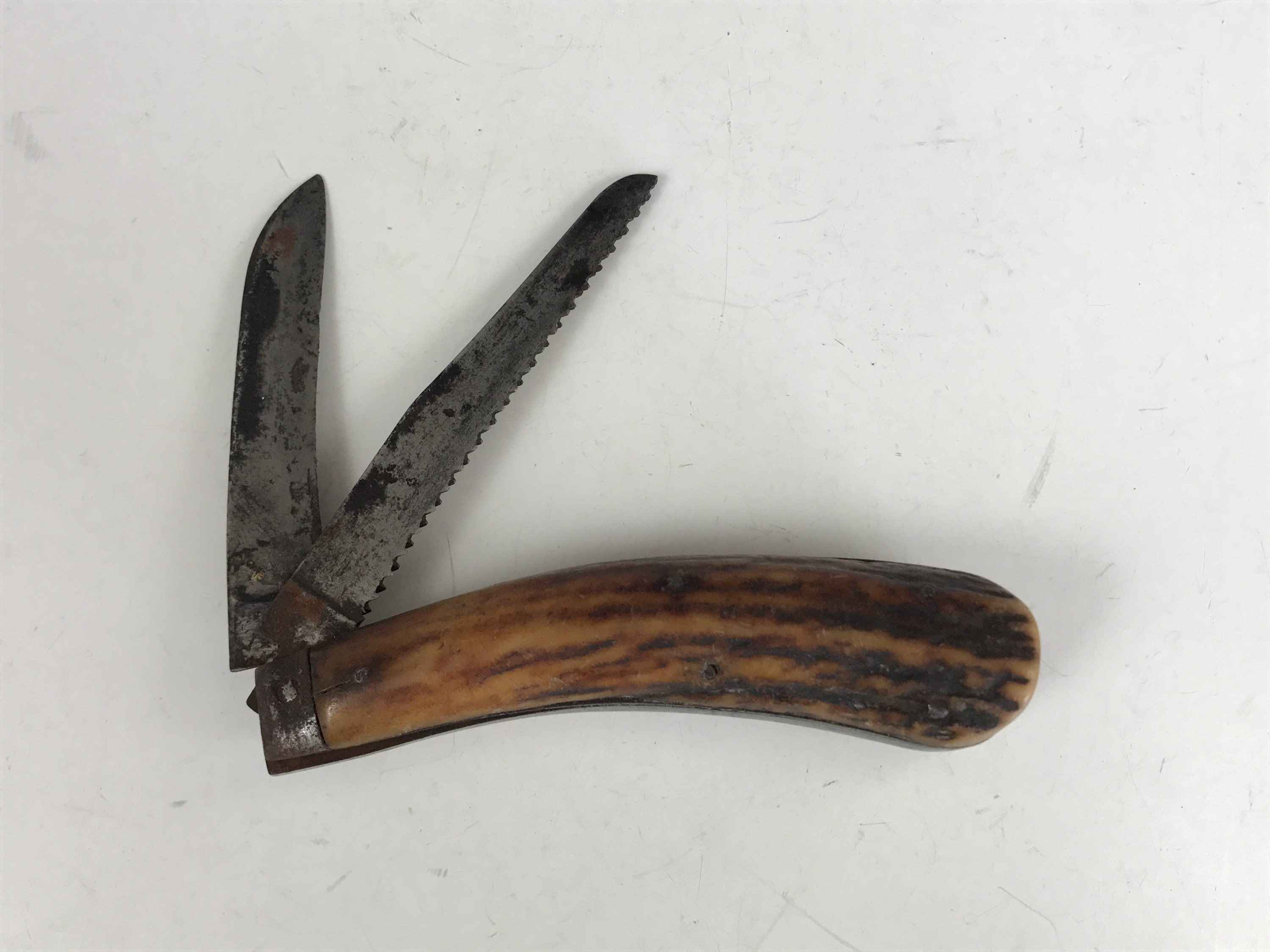 Lot 4 - A Victorian folding pocket knife with saw blade by Harrison Brothers and Howson