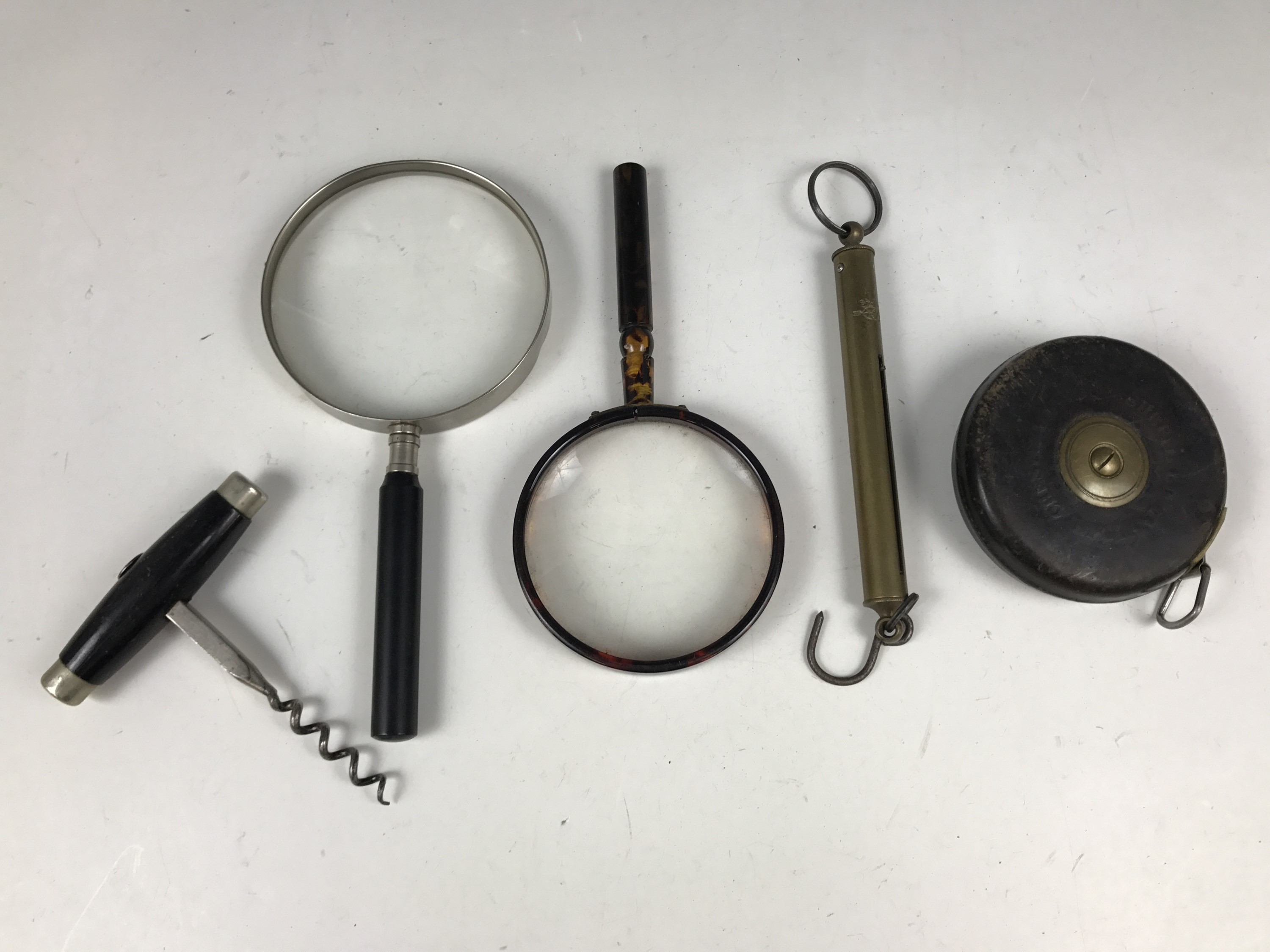 Lot 28 - Two vintage magnifying glasses together with Salter scales, a corkscrew and a Chesterman's 50ft tape