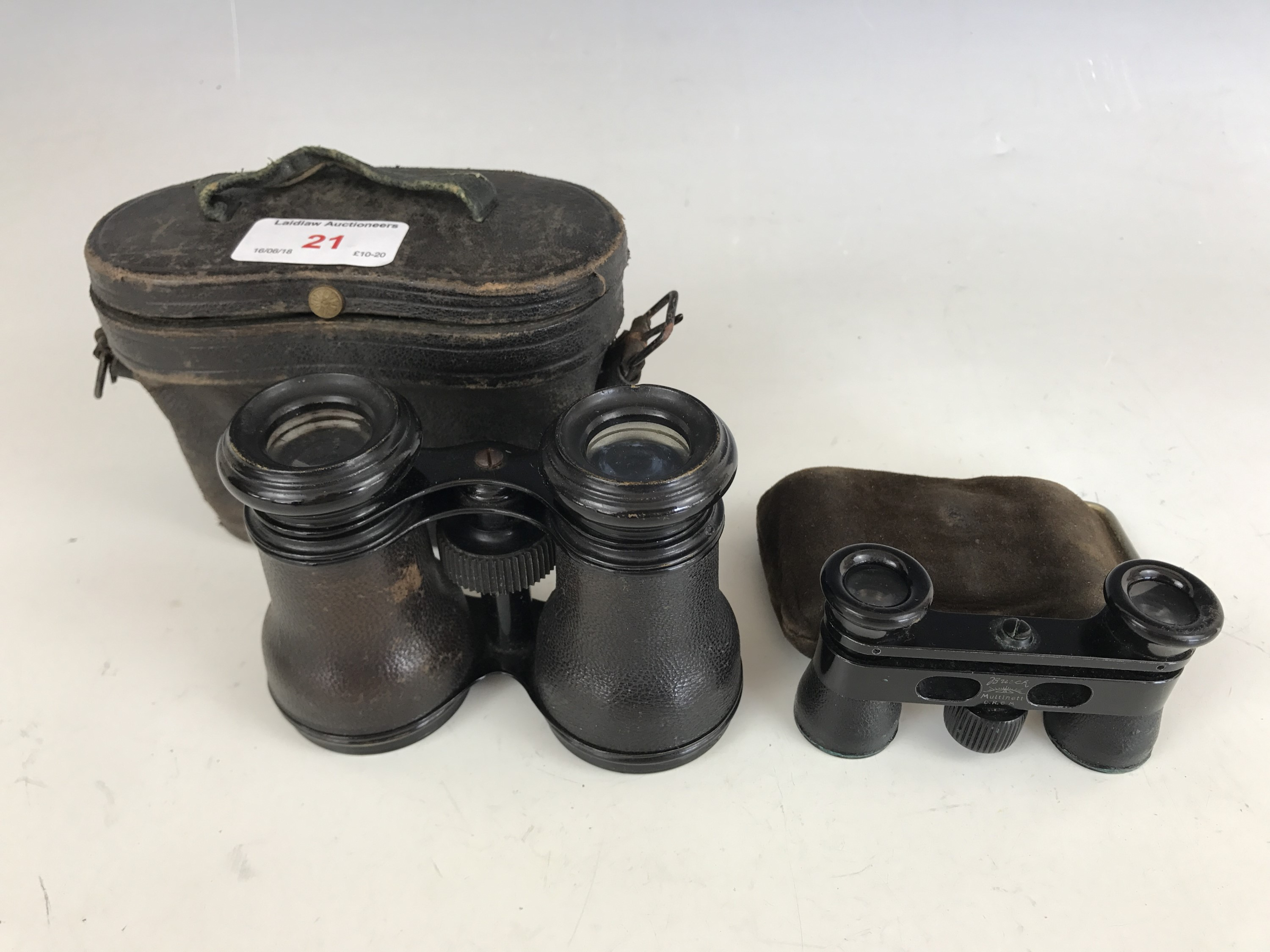 Lot 21 - A cased pair of Busch Multinett D.R.G.M opera glasses together with one other pair
