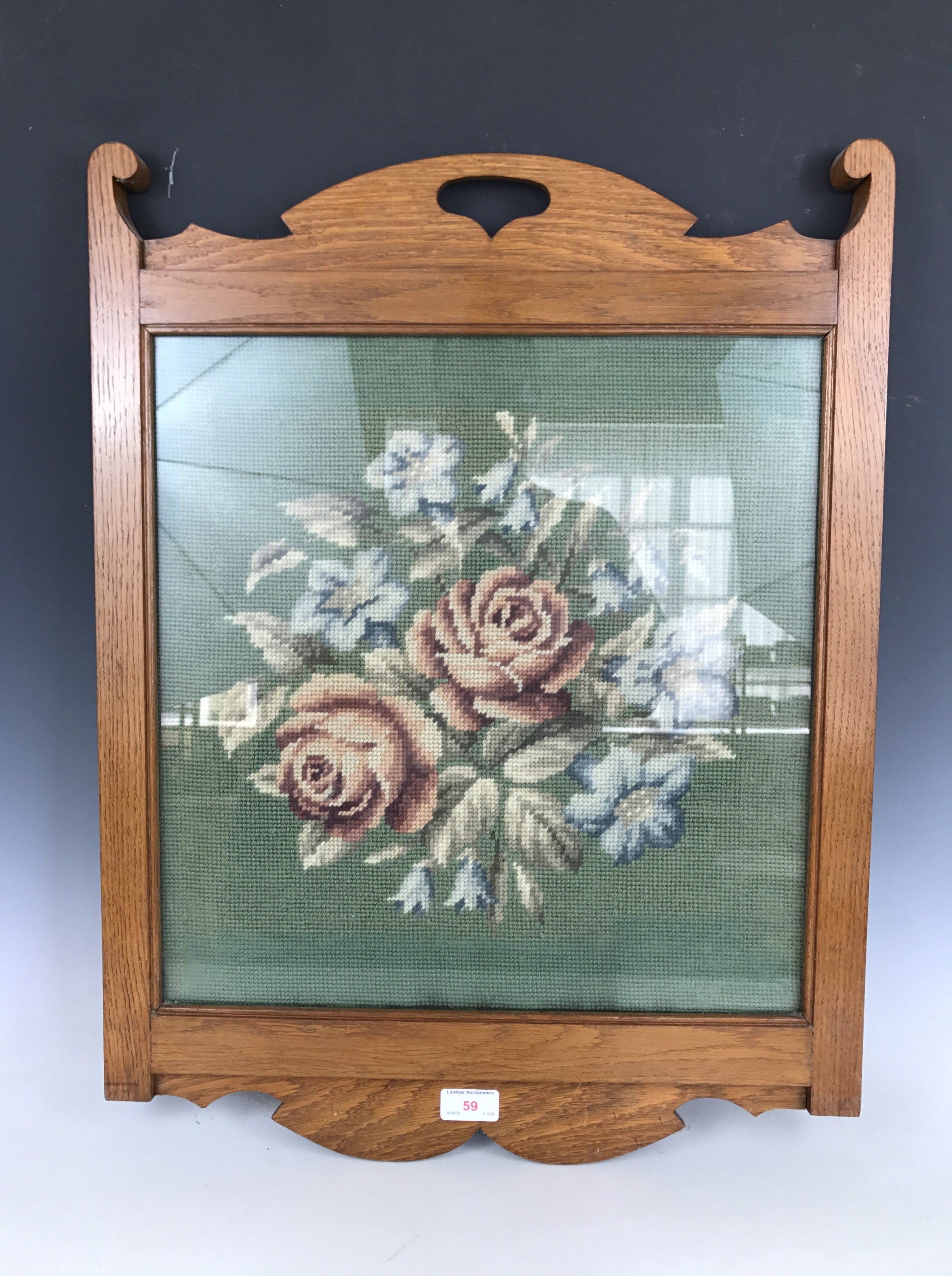 Lot 59 - An early 20th century oak framed woolwork in the arts-and-crafts style