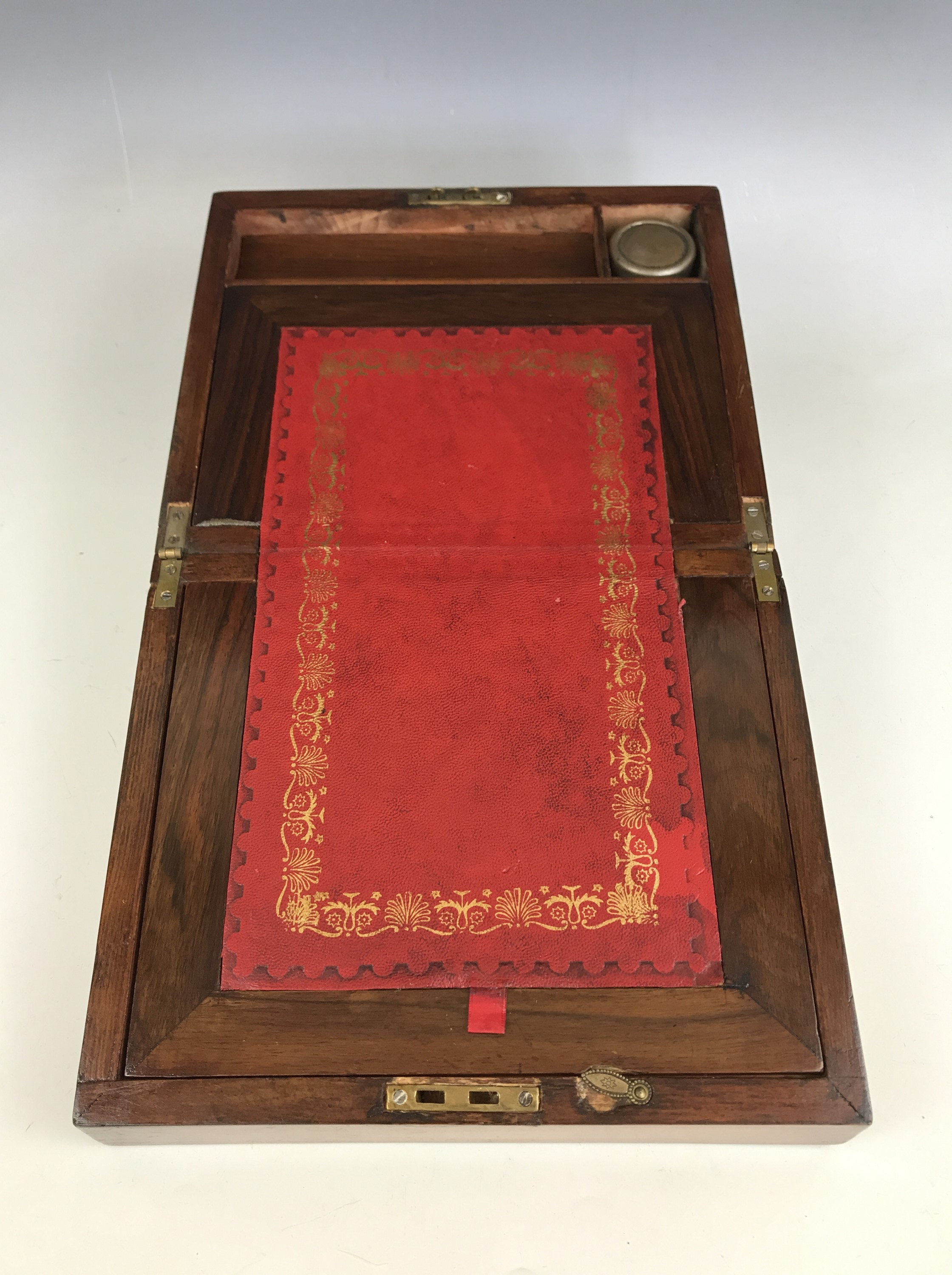 Lot 25 - A small Victorian brass-mounted walnut portable writing desk