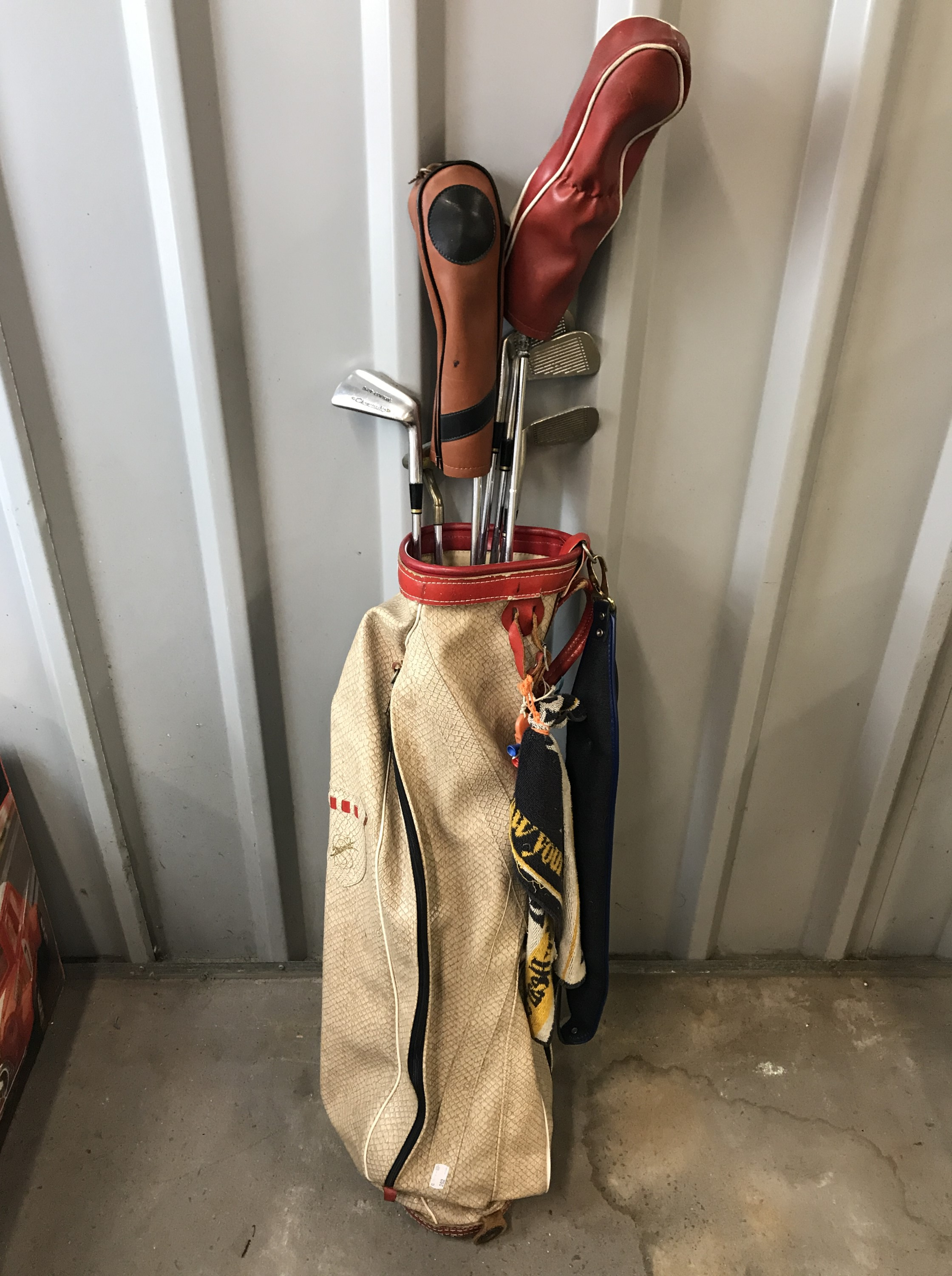 Lot 33 - A vintage golf bag together with Golfco and Championship clubs