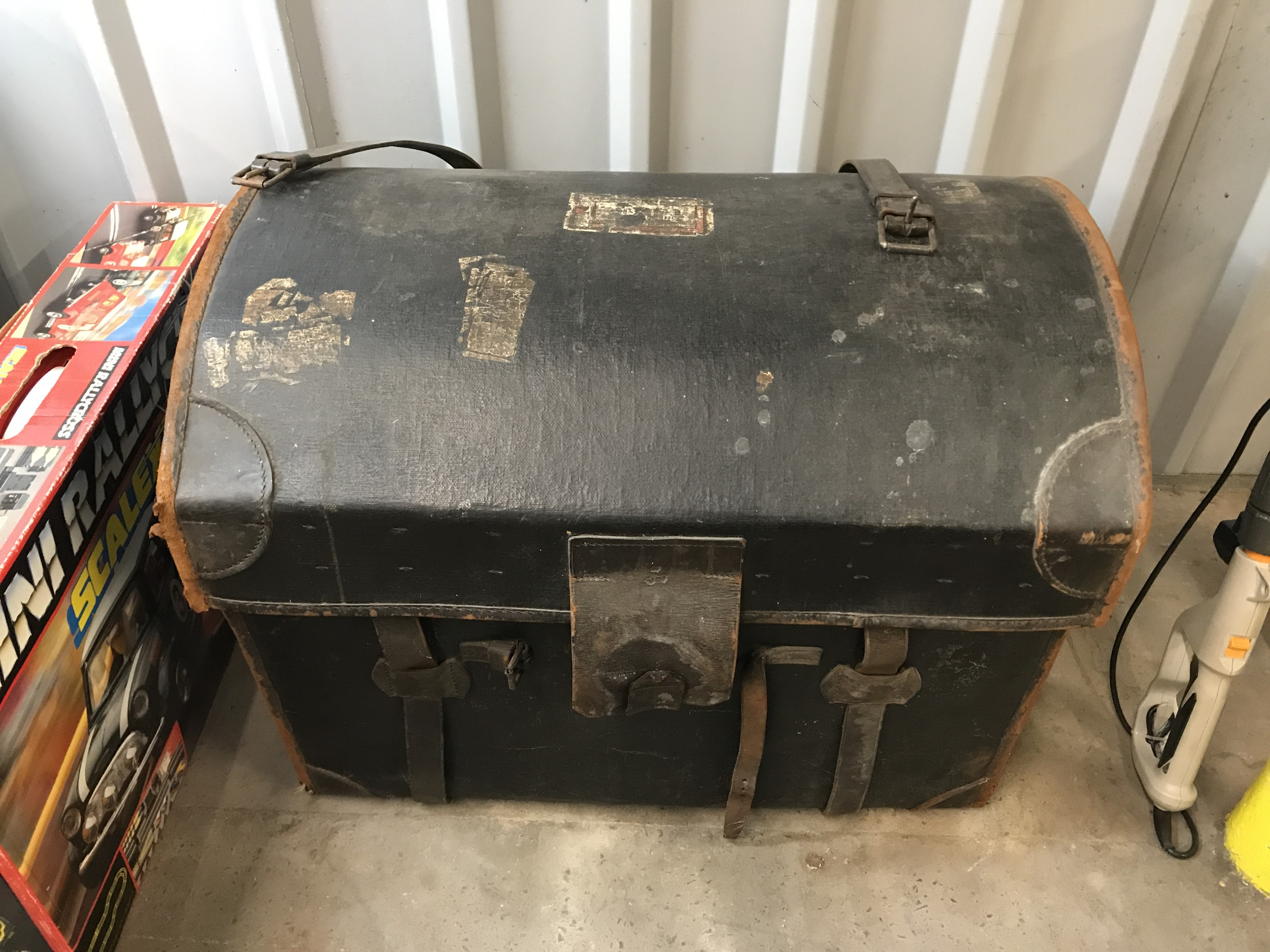 Lot 24 - A Victorian leather-trimmed and Japanned canvas covered wicker travel trunk, with inner tray, the