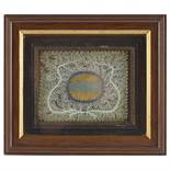 A FRAMED PIECE OF BLUE RIBBON OF JACOBITE INTERESTCONTAINED WITHIN A FRAME, SURROUNDED BY A