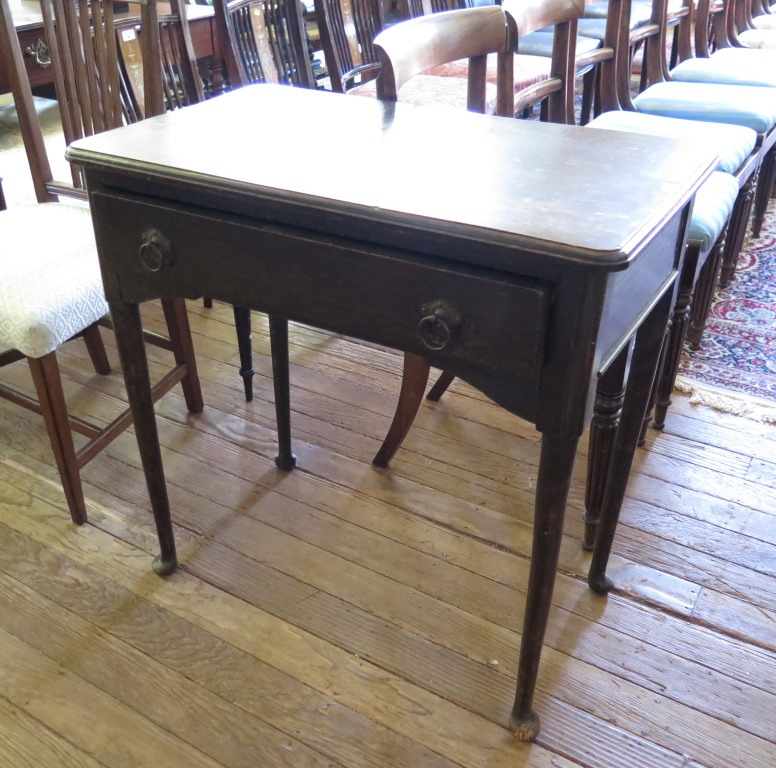 Lot 51 - A George II style oak side table, the top with moulded edge over a frieze drawer on turned