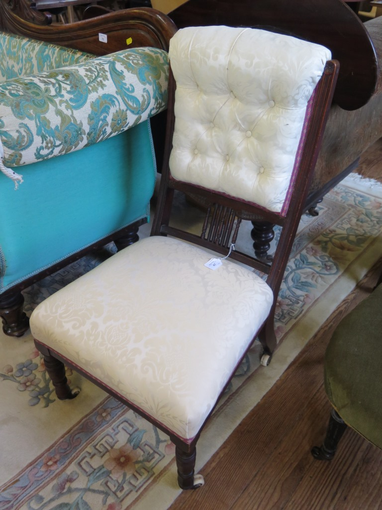 Lot 47 - An Edwardian walnut fireside chair, with button upholstered and spindle back, stuffover seat and