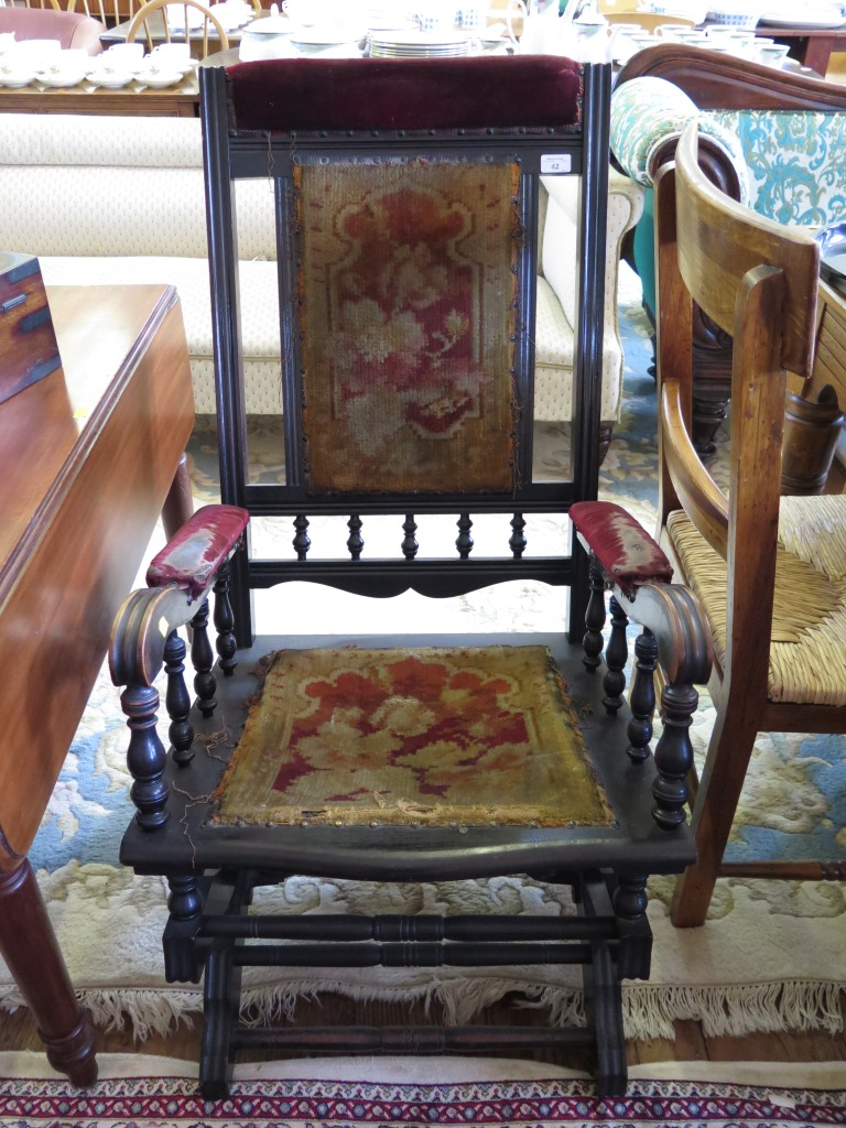 Lot 42 - An Ebonised American rocking chair, with turned supports