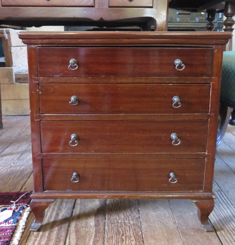 Lot 39 - A miniature mahogany chest of drawers with four long graduated drawers on ogee bracket feet, 44.