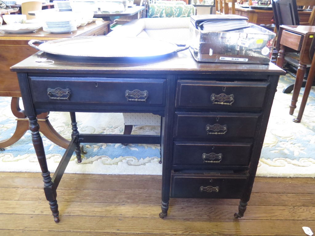Lot 24 - An Edwardian lady's ebonised writing table, the leather inset top over a drawer and kneehole