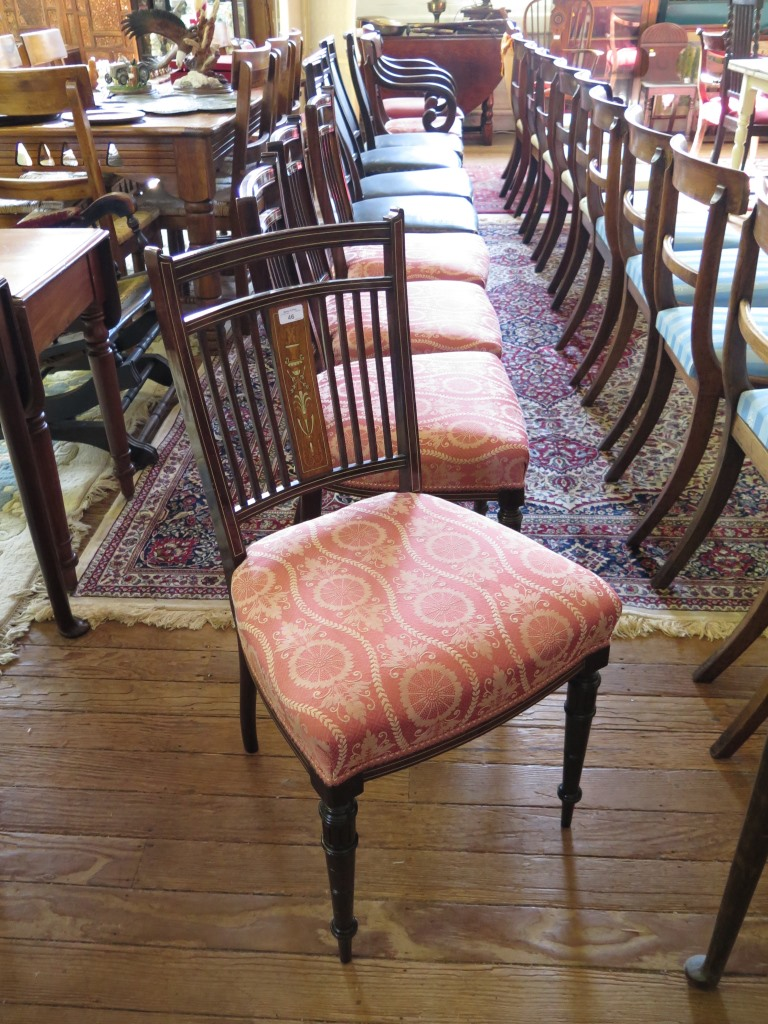 Lot 46 - A set of four Edwardian inlaid salon chairs, the ivorine strung rail backs with anthemion and urn