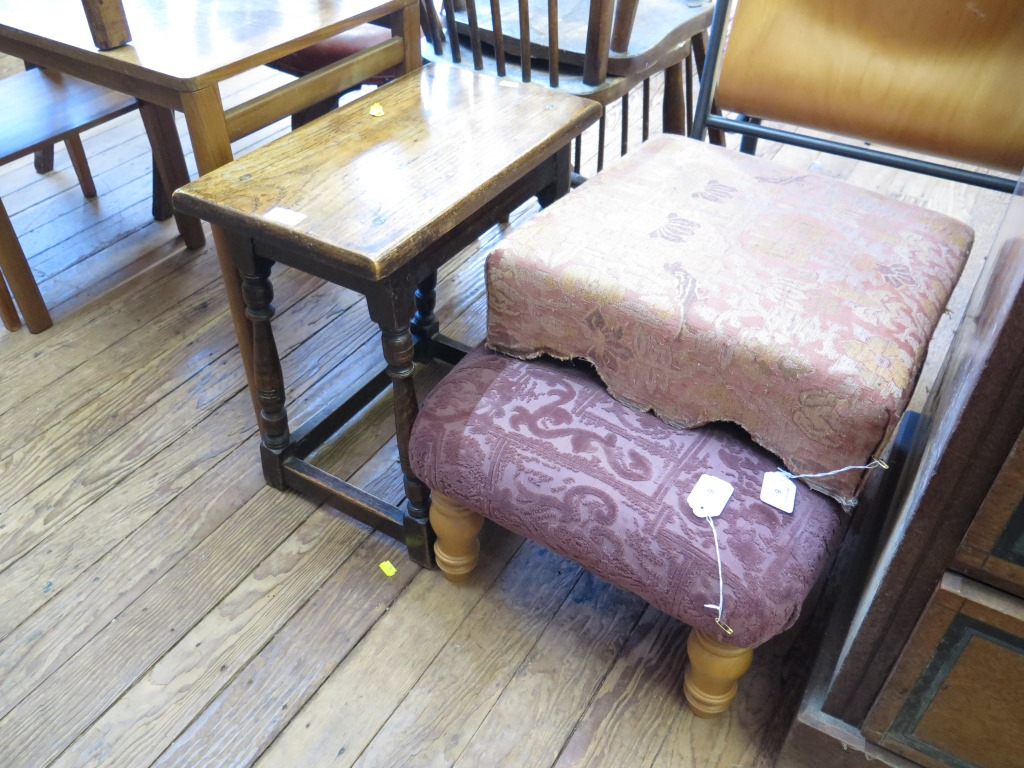 Lot 6 - An oak stool with turned supports and stretchers, an upholstered footstool, and a modern turned wood
