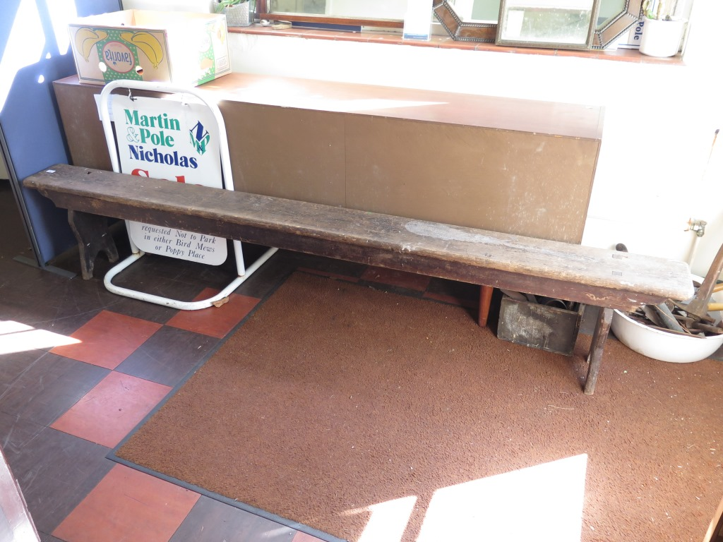 Lot 16 - A long painted pine bench on planked supports 257cm long