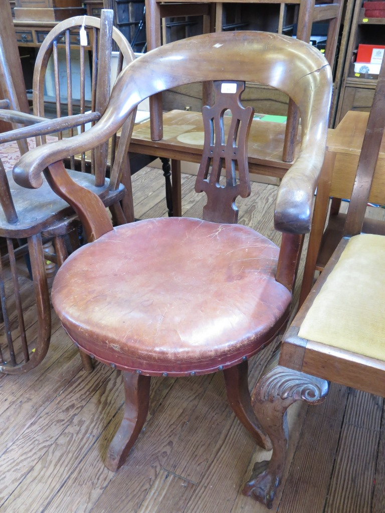 Lot 15 - A 1920s walnut swivel office chair, with pierced splat and leather seat and two hoop back turned