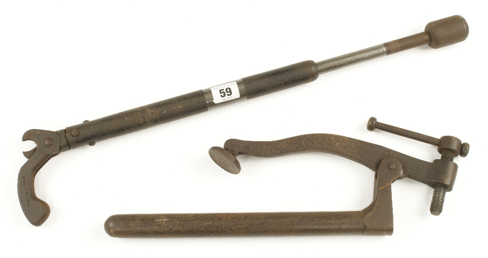 Lot 59 - A bench hold fast and a nail pull G