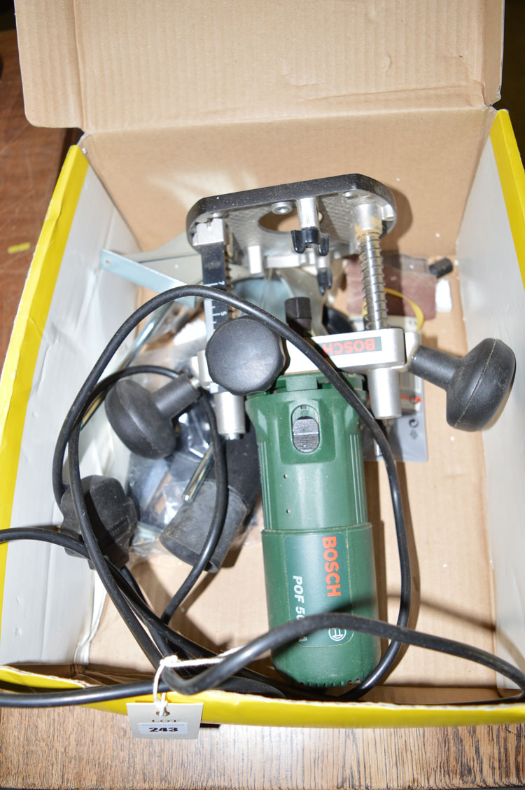 Lot 243 - A Bosch POF 500A electric router and accessories, in a box.