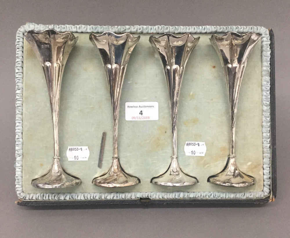 Lot 4 - A set of four silver bud vases (12 troy ounces loaded)