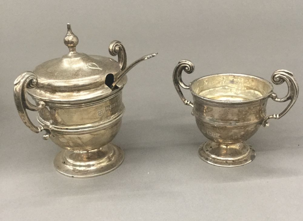 A silver mustard and a miniature silver trophy cup (4.