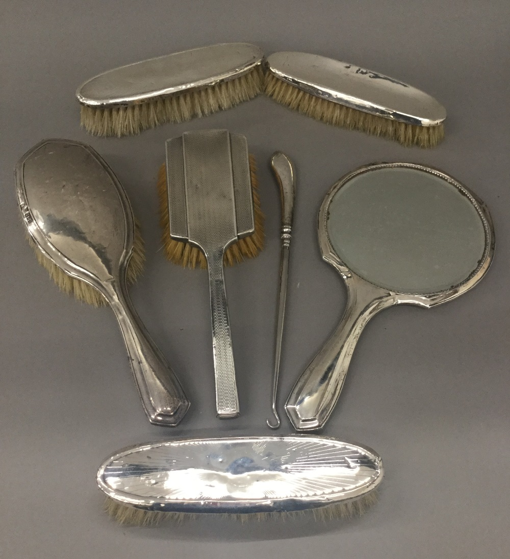 A quantity of silver dressing table items.