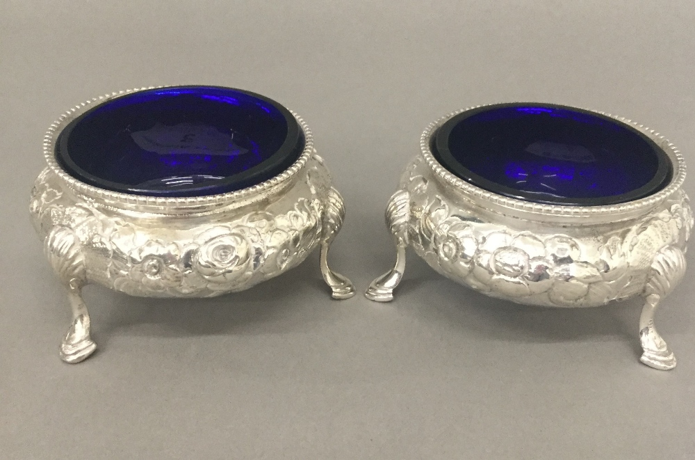 Lot 3 - A pair of Victorian silver salts, with blue glass liners (5.