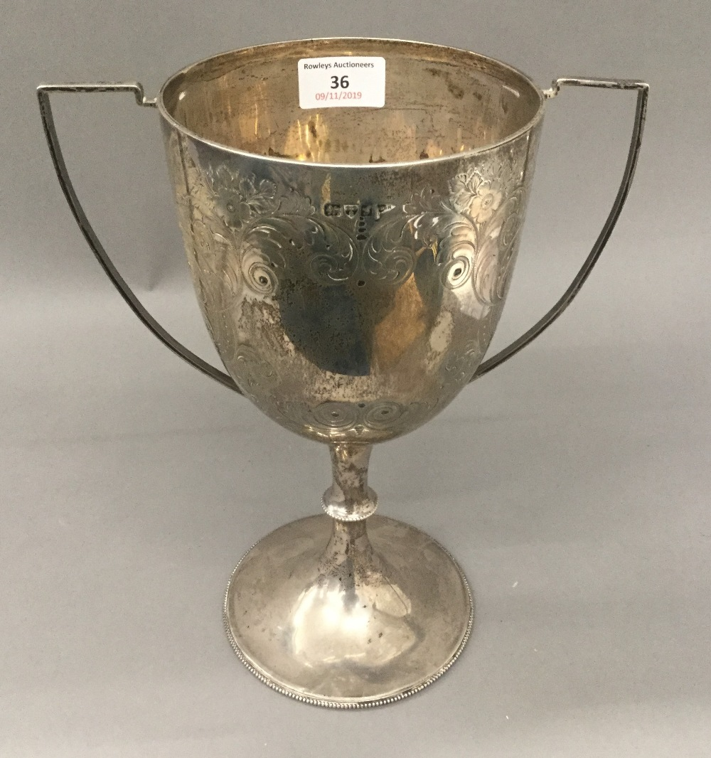 A silver twin handled trophy cup (21.