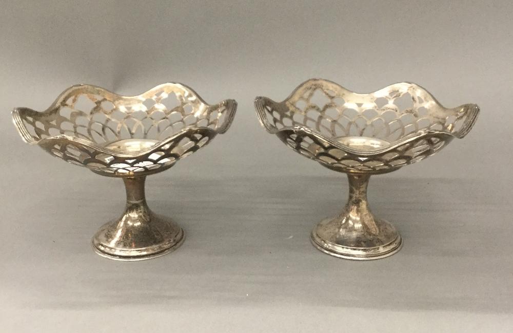 A pair of silver bon bon dishes (5.