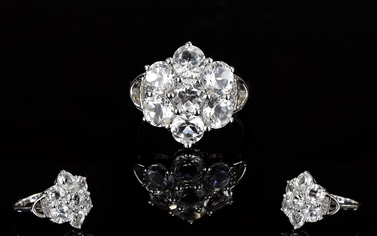 Lot 168 - A Sterling Silver And White Topaz Flower