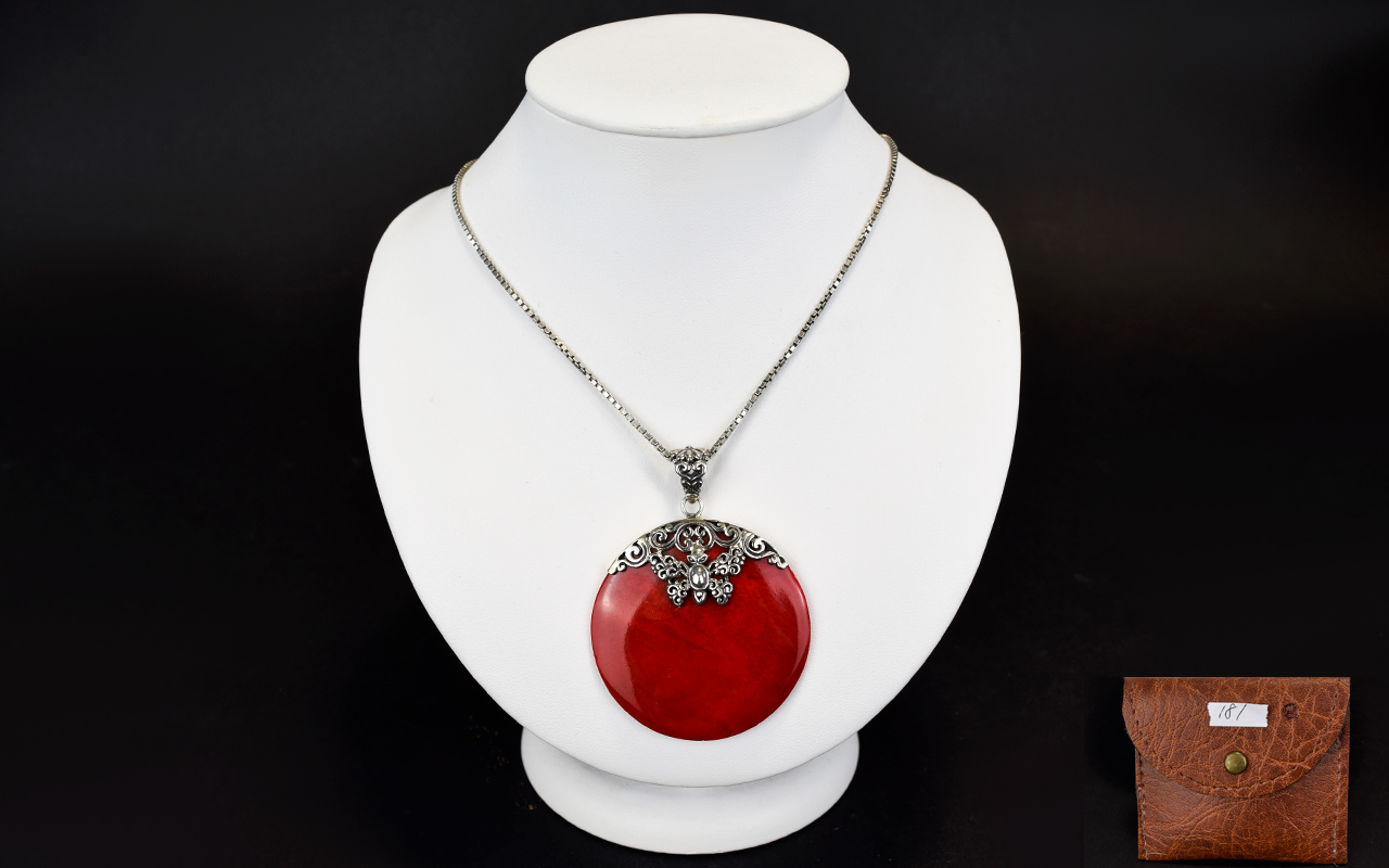 Lot 181 - A Red Coral Disc Pendant With Silver Cha