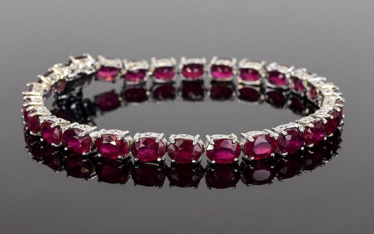 Lot 114 - Ruby Tennis Bracelet, 28cts of oval cut,
