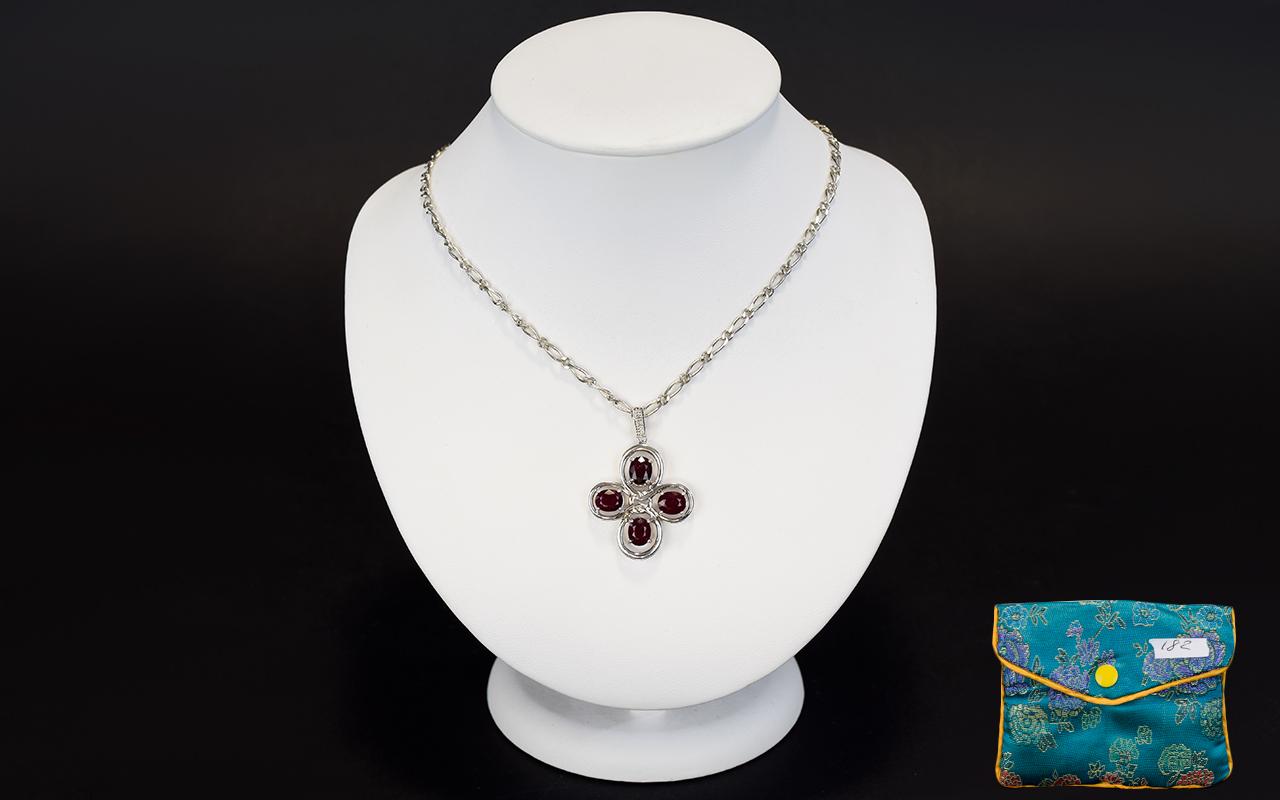Lot 182 - A Silver Ruby And Diamond Pendant Neckla