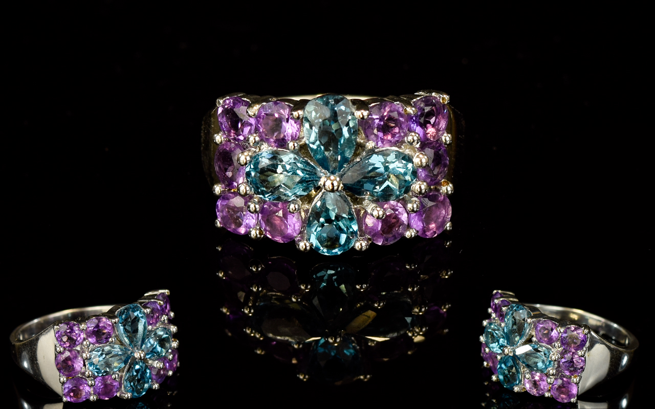 Lot 190 - Ladies Swiss Blue Topaz And Amethyst Sil