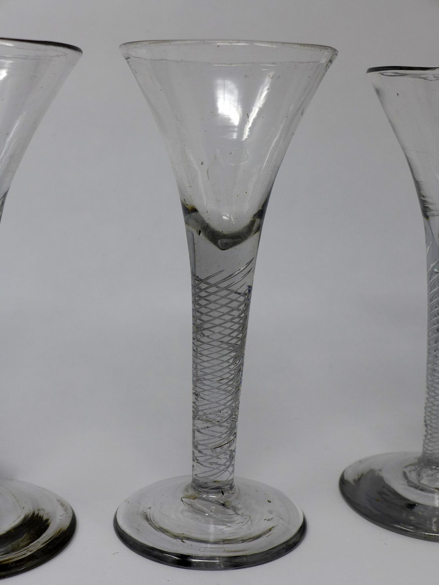 Lot 16 - Three Georgian wine glasses with twist stems, on circular bases, H.17cm