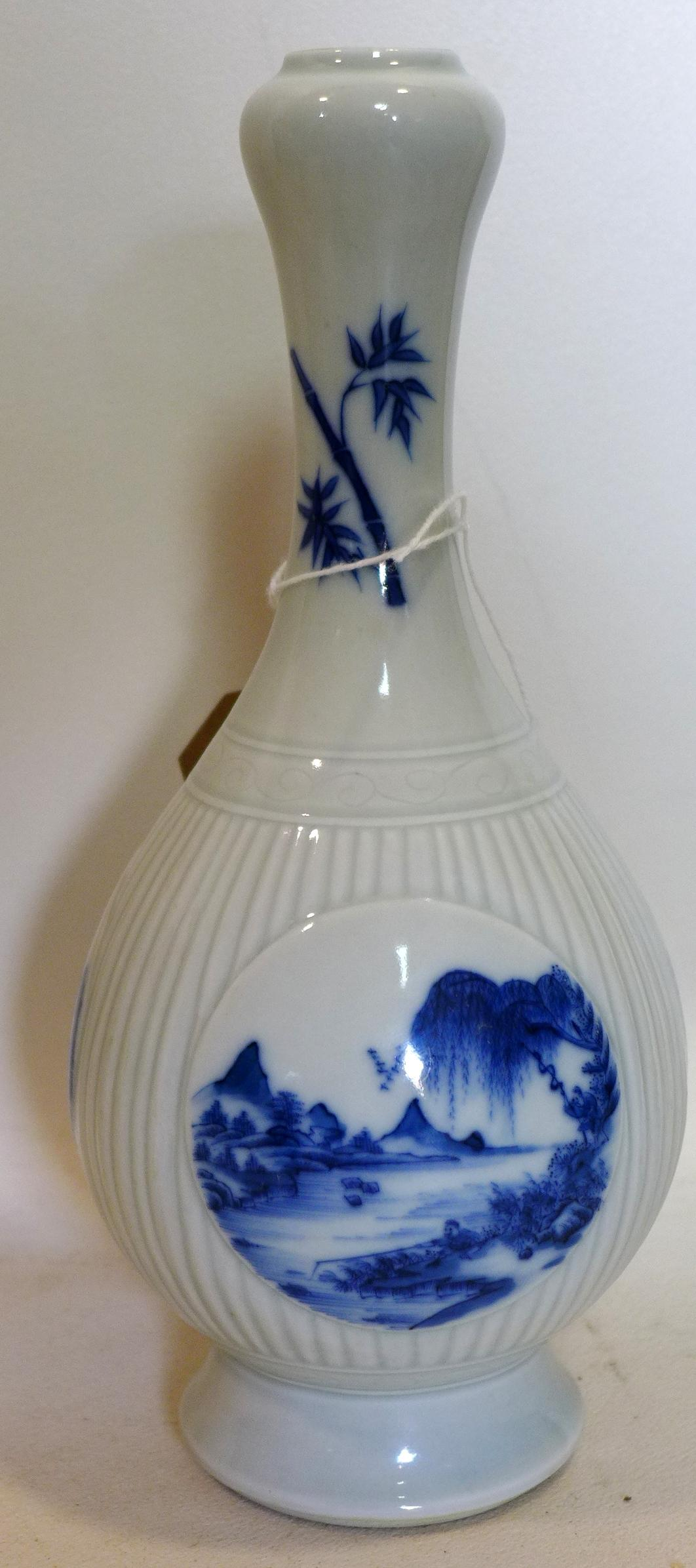 Lot 48 - A Chinese blue and white porcelain vase with six character marks to base, H.25cm